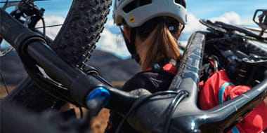 Mountain (MTB) - The key feature of a specifically built women's mountain bike frame is a shorter top tube. Some bike manufacturers have designed curved top tubes on their bikes to aid stand over height for women. As for any rider the springs on any part of the suspension for a mountain bike will need to be adjusted to take account of the weight of the rider.