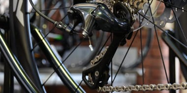 Drivetrain - The drivetrain are components used for a bike's gearing and braking. This comprises the shifters, crankset, front and rear derailleurs, chain, rear cassette and brakes.