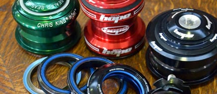 Headsets - Admittedly they're not the most glamorous part of your bike, but a headset performs the vital function of keeping your front end and steering turning smoothly. One of the most common headsets uses the stem that bolts directly onto the steering tube of the forks, though the more traditional 'quill' stem version are still used. We have a fantastic range of top brand headsets in stock.