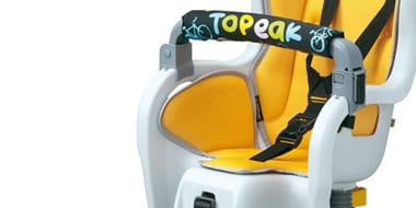 Child Seats - Child Seats allow for your child to sit nice and close to you and are designed to evenly distribute the weight of the child so as to not impede steering or pedalling for the rider. Many models feature adjustable head and footrests allowing the seat to grow with your young one.
