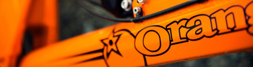 Orange - Orange Mountain Bikes based in Halifax, West Yorkshire. Orange produce a wide range of mtb bikes, ranging from the full-suspension downhill to the steel hardtails. Orange's original hardtail was the Clockwork, named after the film. Entry and mid-level Orange bikes are built in Taiwan, while more expensive models are handbuilt in their Halifax factory where the workforce is fuelled on biscuits and good old Yorkshire Tea.....