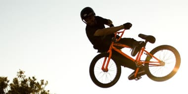 BMX - BMX helmets come in two main designs: Full face and open face. Full face helmets offer protection to meet the demands of BMX racing. Open face (skate style) helmets are more commonly used for flatland riding and dirt jumping.