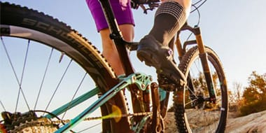 Mountain (MTB) - The majority of women specific mountain bikes are designed around an average women's body. This body standard is smaller, lighter weight, and has a shorter torso and arms than the body standard of the average male that most non-women specific mountain bikes are designed around.